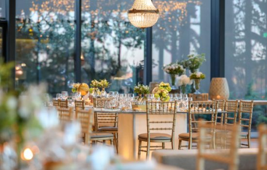 decorated-wedding-hall-with-a-beautiful-table-setting-with-floral-decorations_181624-6509