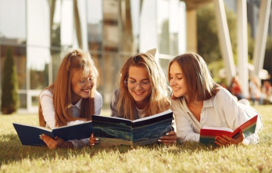 students-at-the-campus-with-books-and-bags_1157-30330